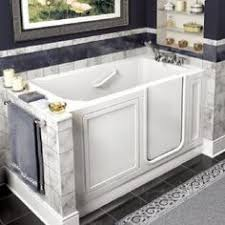 kholer 60 rising wall soaking bath tub a stylish alternative to