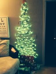 how to put christmas lights on your wall easy diy christmas tree using command clear mini hooks and utensil