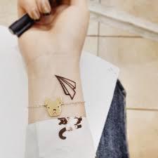 minimalistic paper plane tattoo tattoomagz