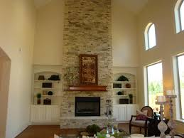 two story great room raised hearth gas fireplace stone home