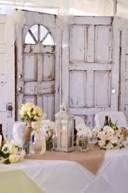 Wedding Backdrop Doors A Clever Way To Use Old Doors And Dried Flowers To Create A Rustic