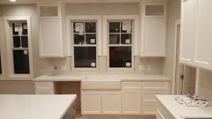 cabinet trim kitchen sink how do we finish this casing on low hanging window above sink
