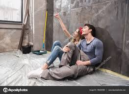 young couple renovating house u2014 stock photo dmitrypoch 150432390
