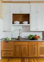 white kitchen cabinets with wood interior wood cabinet clermont kitchens and bath