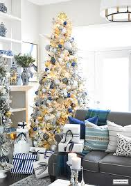 flocked tree with navy light blue silver and gold ornaments