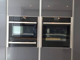 metallic anthracite and white gloss glass edge kitchen welwyn