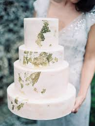 picture of blush marble wedding cake with gold leaf accents