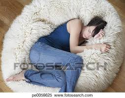 stock image of woman on furry bean bag chair in living room