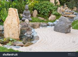 small japanese garden buddha statue stock photo 65031619