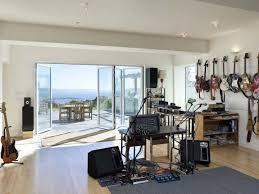 Outdoor Glass Patio Rooms - water view accordion doors speaker music studio room bookshelves