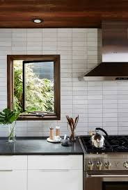 top 25 best modern kitchen backsplash ideas on pinterest earthy modern kitchen with tile backsplash