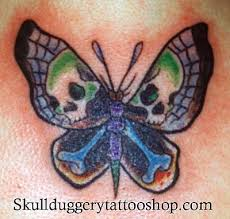 butterfly stylized with skull and bones colored tattoos pm