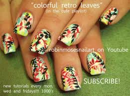 nail art with colorful leaves print on white nails fun nail