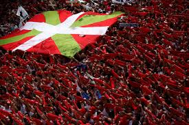 Best Country Flags Revellers Hold Up Their Red Scarves Next To A Basque Country Flag