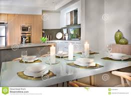 luxurious dining room table set up near to the kitchen stock photo