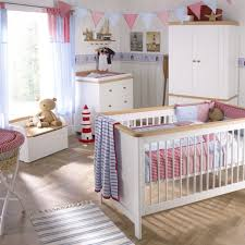 pink and white themed baby nursery room enhanced with