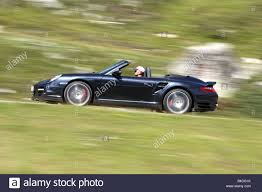 porsche turbo convertible porsche 911 turbo convertible model year 2007 black driving