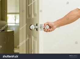 man hand open door knob stock photo 133893713 shutterstock