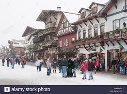people enjoying street fairs shopping and christmas festivities