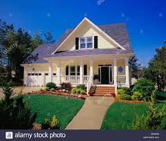 house with porch small two yellow house with black shutters a large porch and