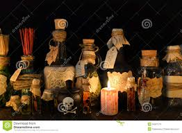 vintage candle with flasks and bottles on witch table stock photo