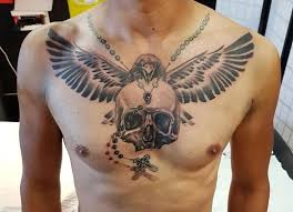 collection of 25 skull and wings on chest