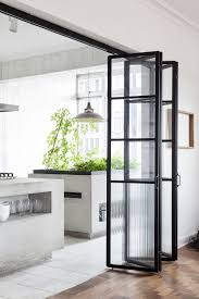 sleek eco friendly kitchen with glass folding doors and indoor
