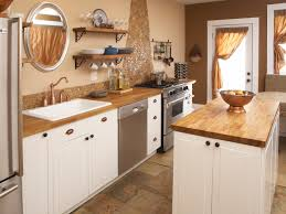 simple brown wood butcher block countertop bronze kitchen faucet
