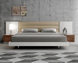 modern extra long headboard bed with beige cushions beds