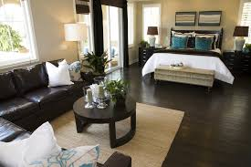 bedroom with dark brown hard flooring and furniture contrasting