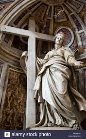 statue of jesus christ with cross in a basilica st peter u0027s stock
