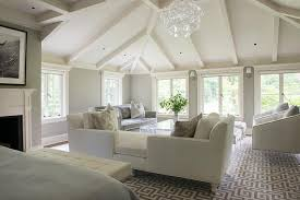 master bedroom living space with white tete a tete sofa