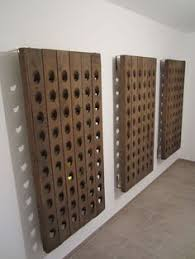 salvaged french oak riddling rack now wall hung with metal