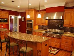 granite countertop sektion kitchen cabinets yellow backsplash