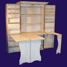 craft cabinet with fold out table sewing scrapbooking cabinet studio craft room pinterest