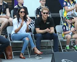 prince harry and meghan markle hold hands at invictus games