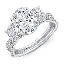 stone wedding rings images Uneek oval diamond three stone engagement ring with pave jpg