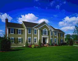 gorgeous exterior design with green vinyl siding by certainteed