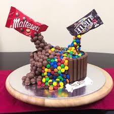 cake designs spill m m and maltesers chocolates gravity defying cake