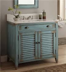 how to install a bathroom wall cabinet sage green rustic wall cabinet with white counter and floral printed