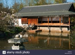 japanese tea house and traditional garden ornament a
