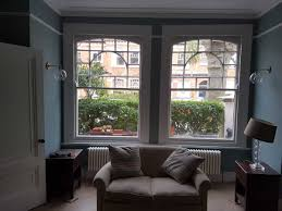 cafe style shutters for large traditional sash windows of detached