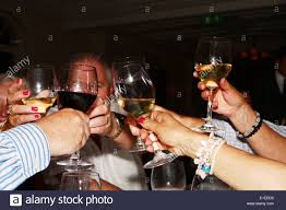 raising glasses of wine in a toast during a birthday dinner