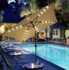 a magical evening rectangular patio umbrella with solar lights