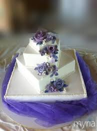 square white tiered wedding cake with purple flowers myria