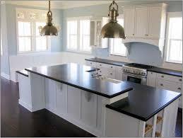 kitchen backsplash white cabinets gray countertop dark floors