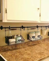 cheap kitchen organization ideas avoid clutter by using the backsplash as storage diy home
