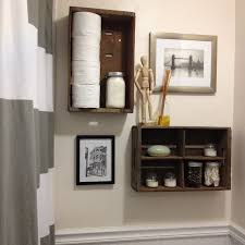 floating brown wooden shelves and pictures on the cream wall