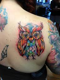 watercolor owl tattoo on side of thigh