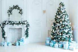 christmas living room with a christmas tree gifts and a large